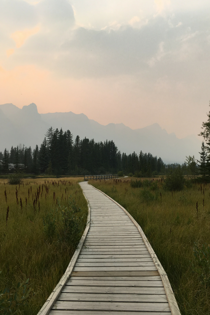 Canmore Alberta Things to Do Where to Stay In Banff Three Sisters Mountains Policeman's Creek Boardwalk Canmore Condos Bow River