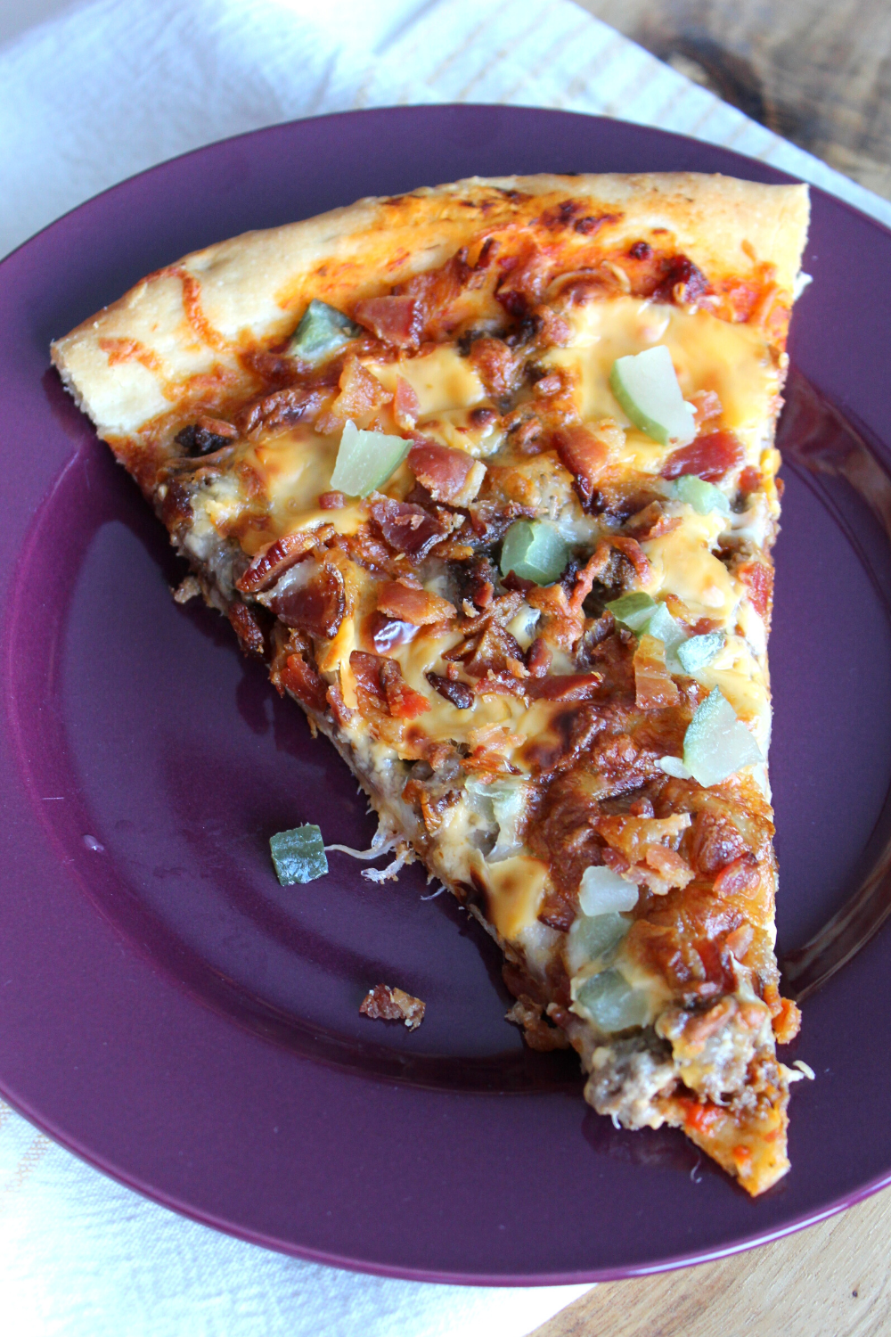Homemade Bacon Cheeseburger Pizza Recipe Crisp and Chewy Crust with a rich tomato sauce topped with ground beef mozzarella and American cheese bacon and dill pickles My Farmhouse Table Quick and Easy The Best Pizza Recipe for Making at Home